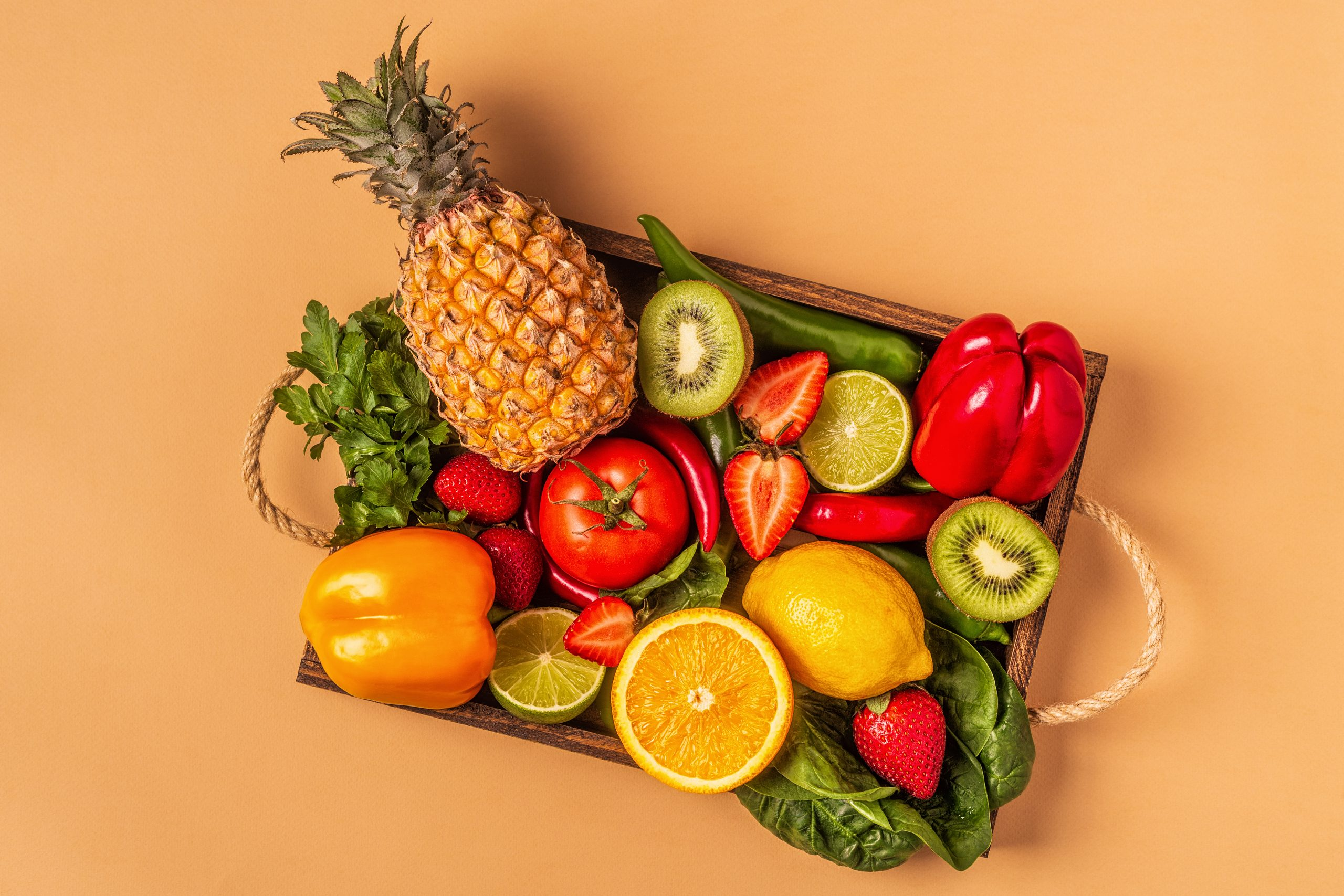 Fruits and vegetables rich in vitamin C in box.